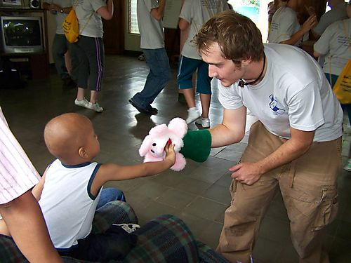 Andrew bringing a smile to a cancer patient